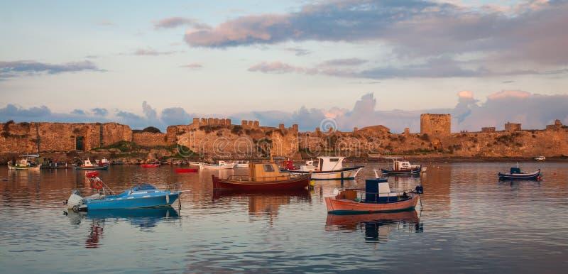 Fishing boats in the bay near Methoni, Peloponnese, Greece. Image of fishing boats in the bay near Methoni, Peloponnese, Greece stock images