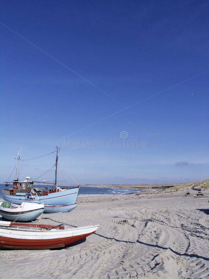 Fishing boats on the beach royalty free stock image
