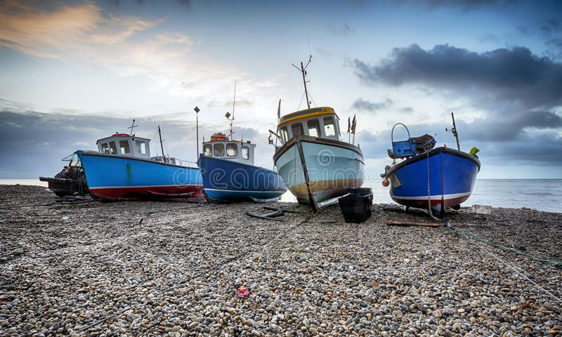 Fishing boats on the beach at Beer in Devon stock image
