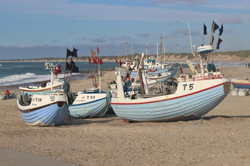 Fishing boats on the beach, Denmark. VORUPOR, DENMARK - JULY 9, 2016: Fishing boats on the beach of Norre Vorupor, a small town on the West Coast of Denmark royalty free stock image