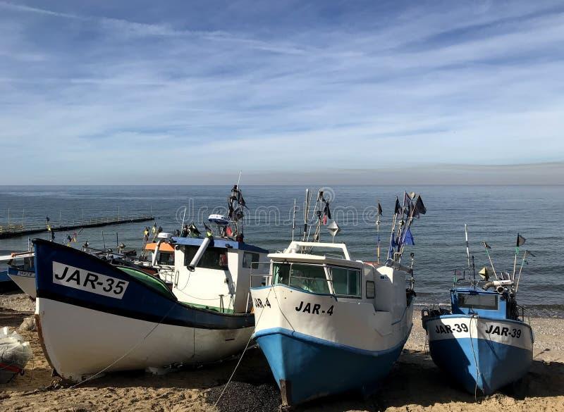Fishing boats on the beach of Jaroslawiec Poland royalty free stock photos