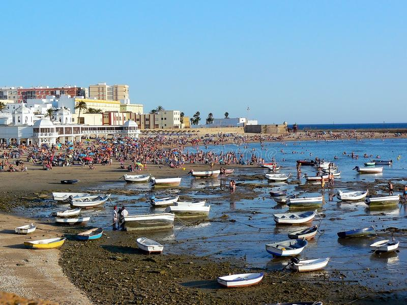 Fishing boats on the beach of La Caleta in the bay of the capital of Cadiz, Andalusia. Spain. stock images