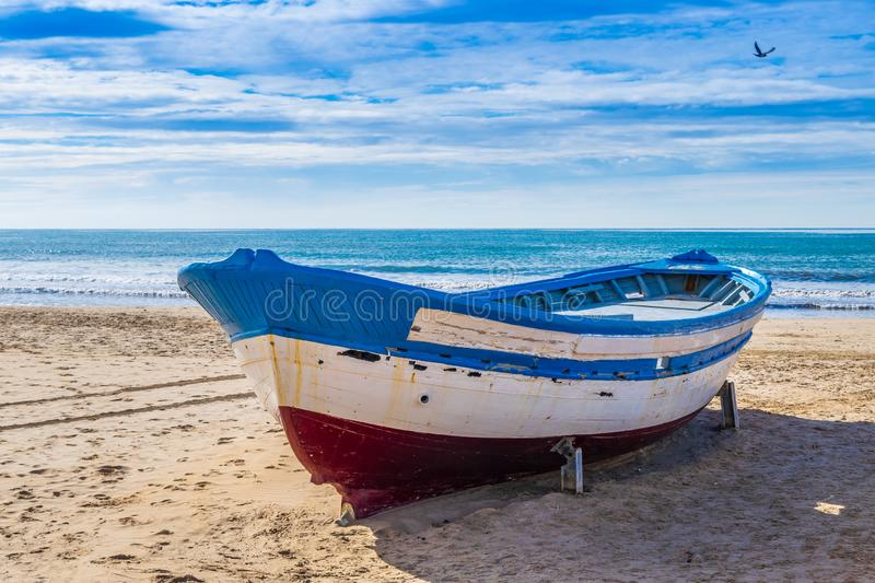 Fishing boats at the beach in Salou stock image