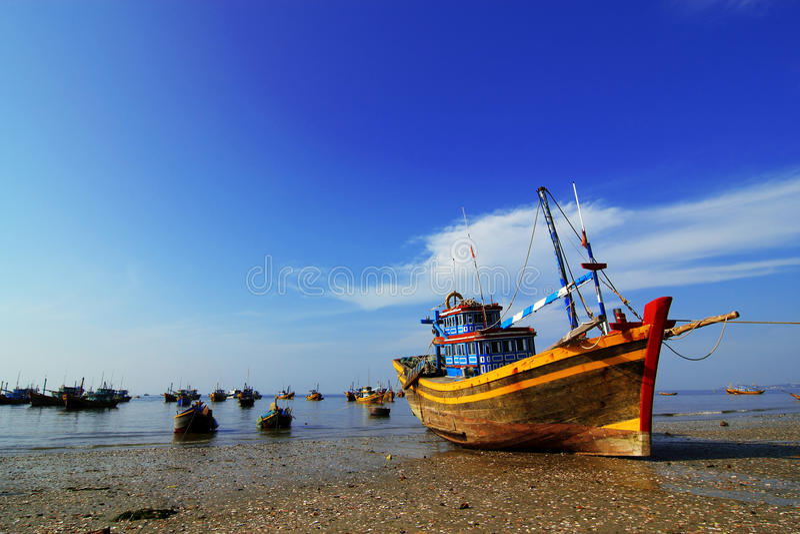 Fishing Boats at Beach in Vietnam royalty free stock photos