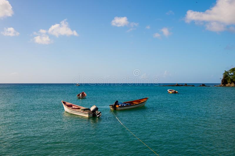 Fishing boats in blue sea on sunny sky in castries, st.lucia. Summer vacation in tropics. Fishing and recreation on tropical islan stock photo