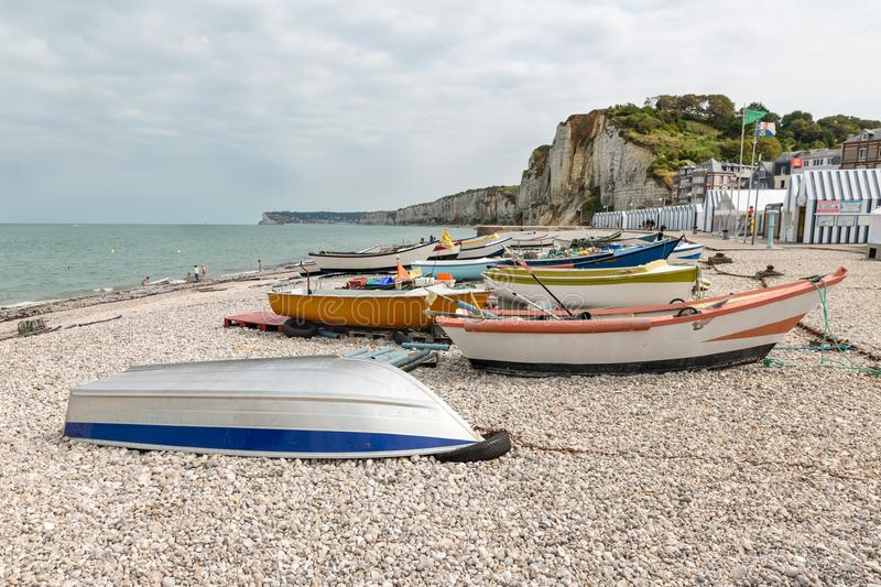 Fishing boats at the beach of Yport in Normandie, France. Fishing boats and chalets at the pebble beach of Yport in Normandie, France stock photos