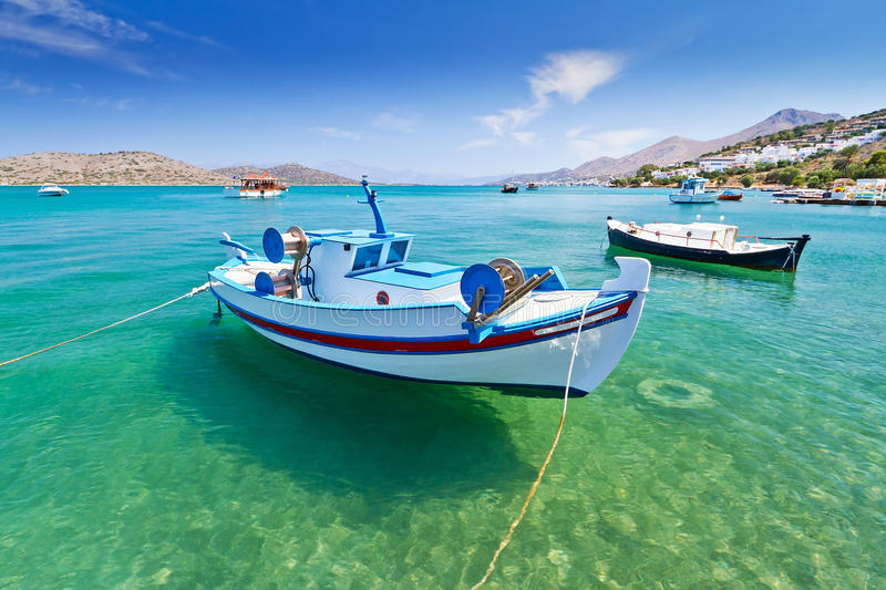 Fishing boats at the coast of Crete stock image