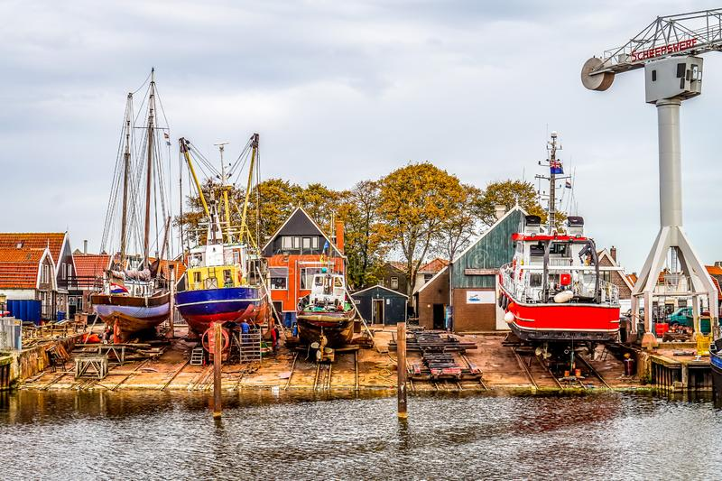 Fishing boats in the dry dock in the harbor of the fishing village of Urk in the Netherlands royalty free stock image