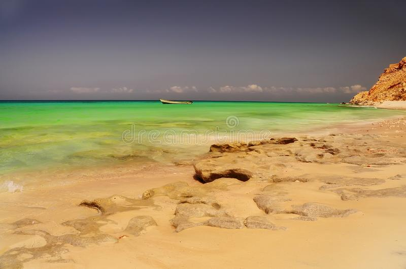 Fishing boats in the emerald water of the Indian Ocean on the shores of a wild island. royalty free stock photos