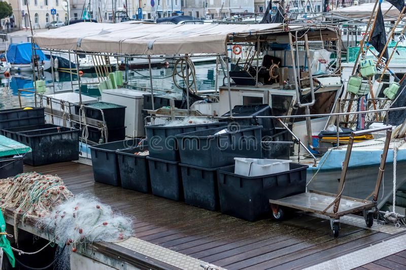Fishing boats and equipment. In the bay royalty free stock photos
