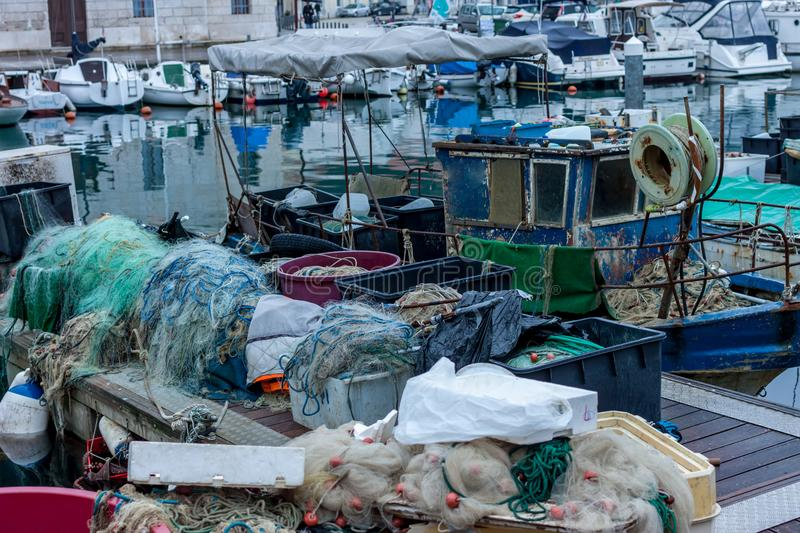 Fishing boats and equipment. In the bay royalty free stock photography