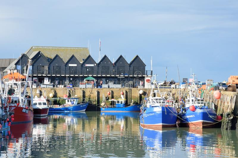 Fishing Boats and fishermans sheds in Whitstable Harbour stock images