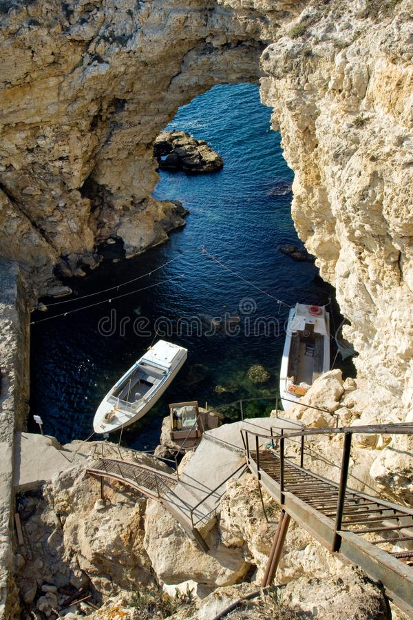 Fishing boats in the grotto stock photos