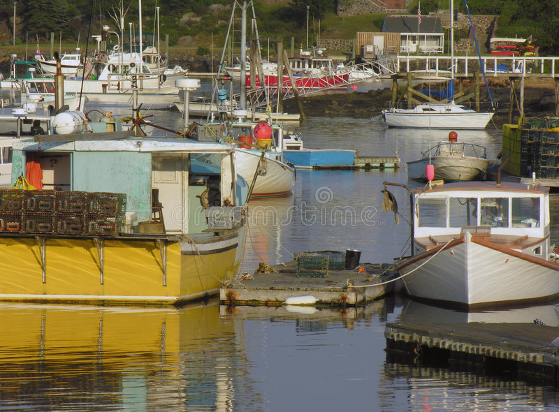 Fishing boats in harbor stock photography