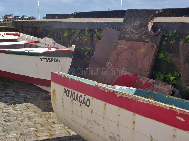 Fishing boats in the harbor of Povoacao, on the island Sao Miguel, Azores. Povoacao, Sao Miguel, Azores – March 23, 2012: Fishing boats in the harbor of royalty free stock photo