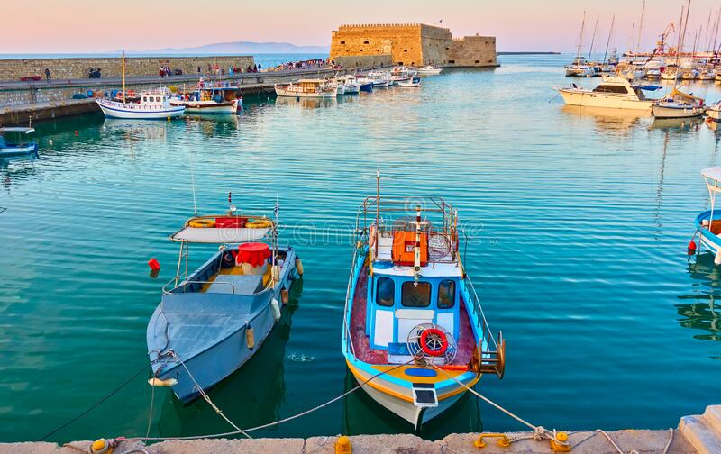 Fishing boats in the harbour in Heraklion stock images