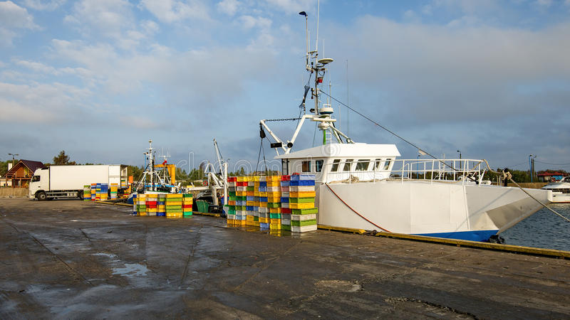 Download Fishing Boats In A Harbour,loading Fish On Refrigerated Vehicles Stock Photo - Image: 48000896