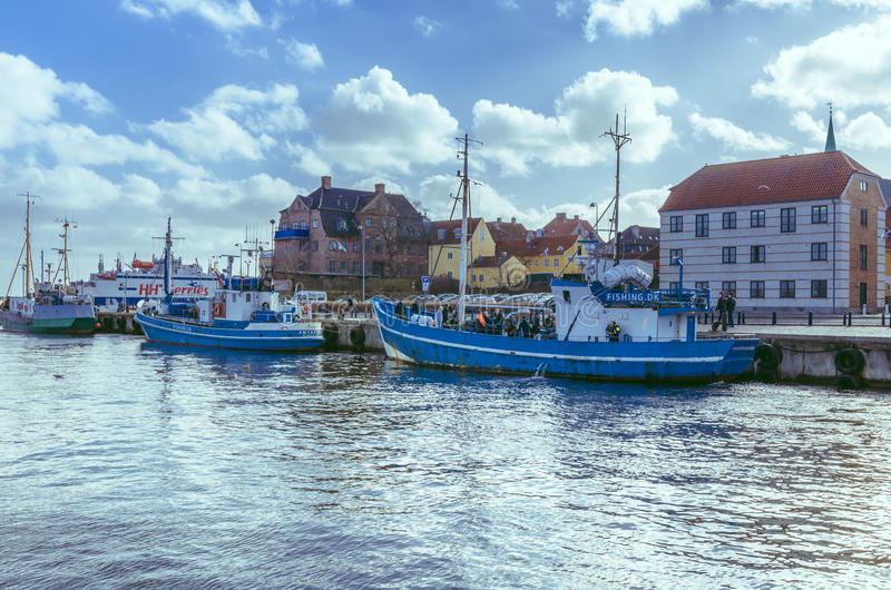 Fishing boats in Helsingor, Denmark. Fisherman and fishing boats anchored at sea dock in Helsingor, Denmark. Photo taken on March 04, 2015 in Helsingor, Denmark stock image