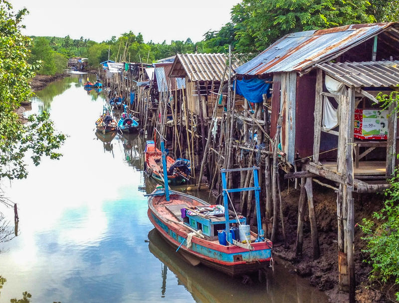 Fishing boats and huts royalty free stock images