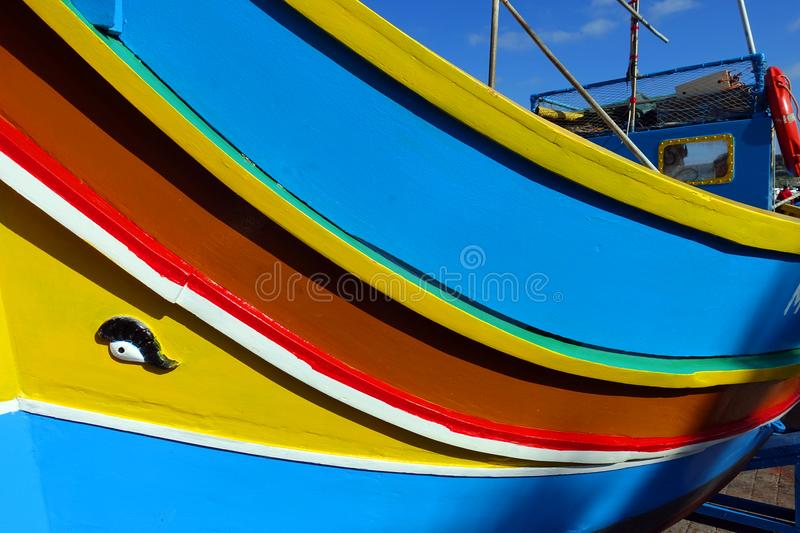 Fishing Boats Marsaxlokk, Malta. A brightly painted traditional fishing boat, known as a luzzu, is in dry dock at the harbor of Marsaxlokk on the island of Malta royalty free stock photography