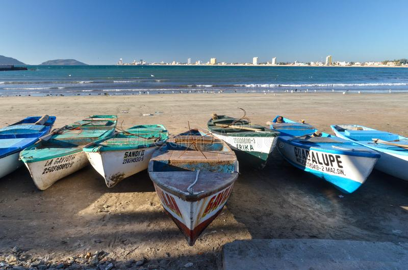 Wide angle view of fishing boats of Mazatlan, Mexico. With various resorts shown across the bay royalty free stock photography