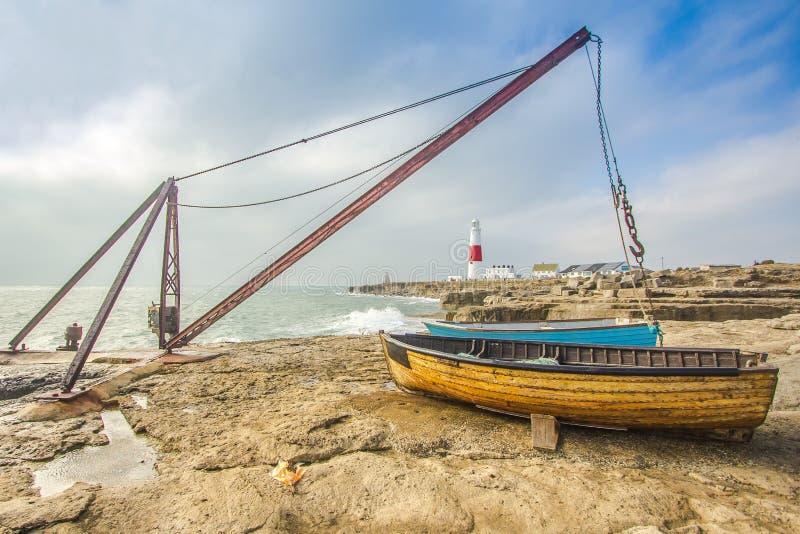 Fishing boats moored on beach stock image