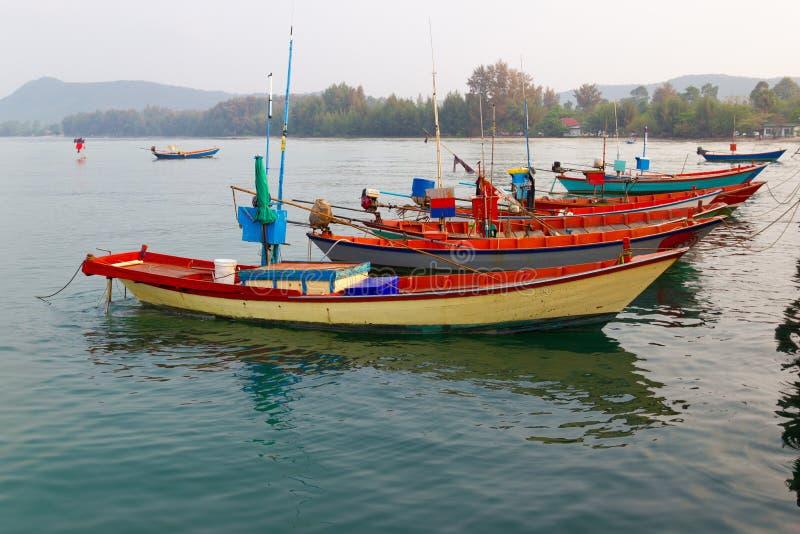 Fishing boats moored at dock Fisherman way of life royalty free stock photo