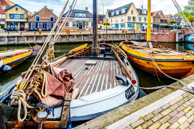 Fishing Boats moored in the harbor of Bunschoten-Spakenburg in. Traditional Wooden Fishing Boats, called Botters, moored in the harbor of the historic fishing stock images