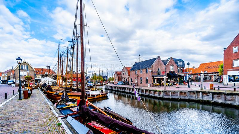 Fishing Boats moored in the harbor of Bunschoten-Spakenburg in. Traditional Wooden Fishing Boats, called Botters, moored in the harbor of the historic fishing royalty free stock images