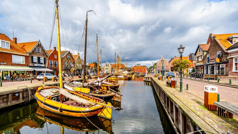 Fishing Boats moored in the harbor of Bunschoten-Spakenburg in. Traditional Wooden Fishing Boats, called Botters, moored in the harbor of the historic fishing stock photo