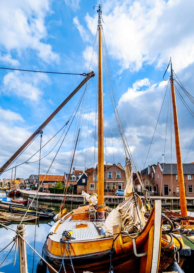 Fishing Boats moored in the harbor of Bunschoten-Spakenburg in. Traditional Wooden Fishing Boats, called Botters, moored in the harbor of the historic fishing royalty free stock photography
