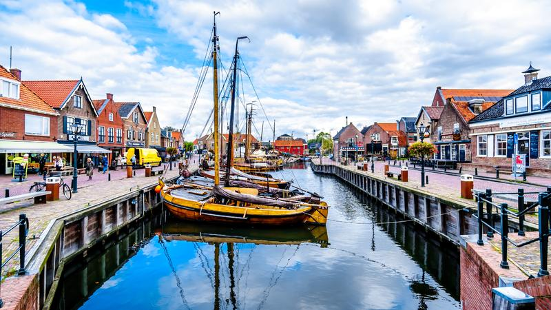 Fishing Boats moored in the harbor of Bunschoten-Spakenburg in. Traditional Wooden Fishing Boats, called Botters, moored in the harbor of the historic fishing stock photos
