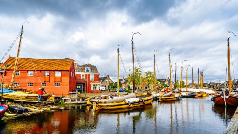 Fishing Boats moored in the harbor of Bunschoten-Spakenburg in. Traditional Wooden Fishing Boats, called Botters, moored in the harbor of the historic fishing royalty free stock image