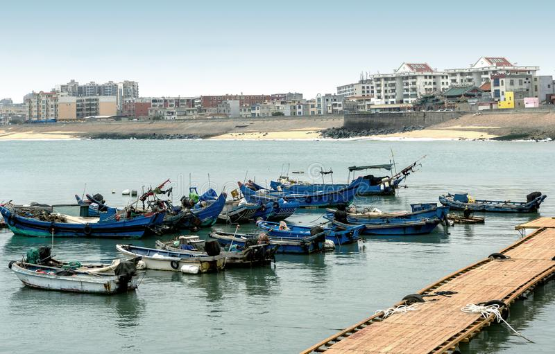 Fishing boats in the harbor stock photos
