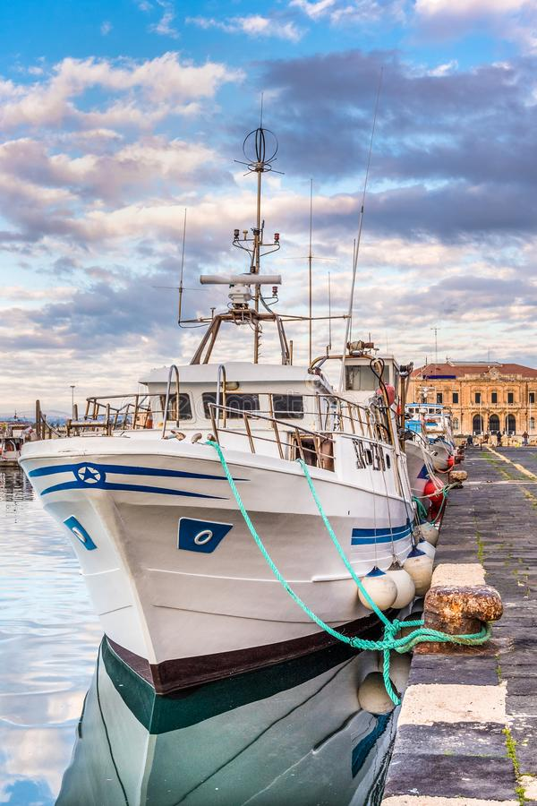 Fishing boats moored in the pier royalty free stock images