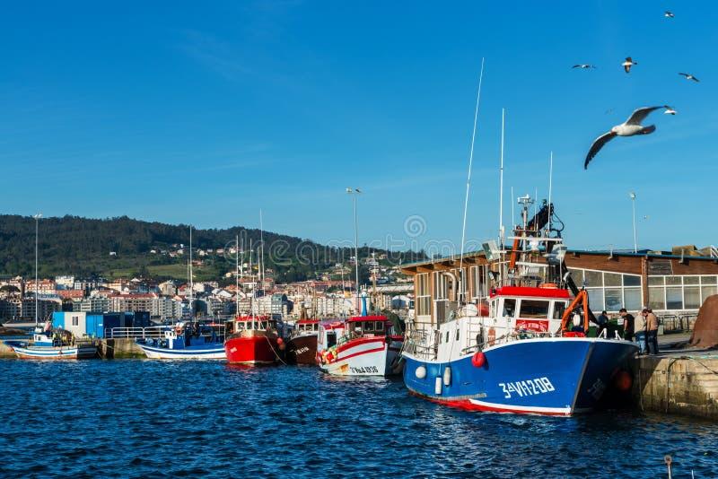 Fishing boats moored in Portonovo port, Galicia stock image