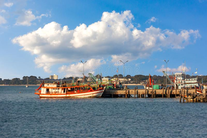 Fishing boats moored in Thailand with blue sky clouds. Nnn royalty free stock photography