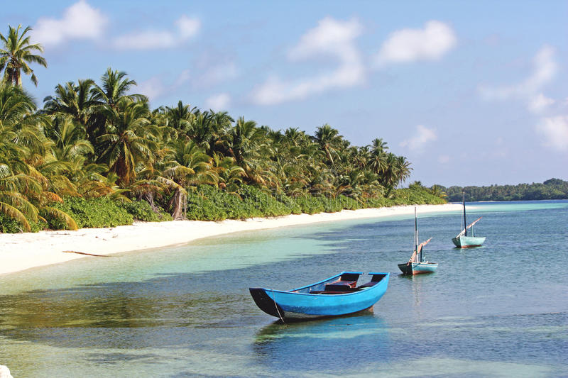 Fishing boats near local tropical island royalty free stock images