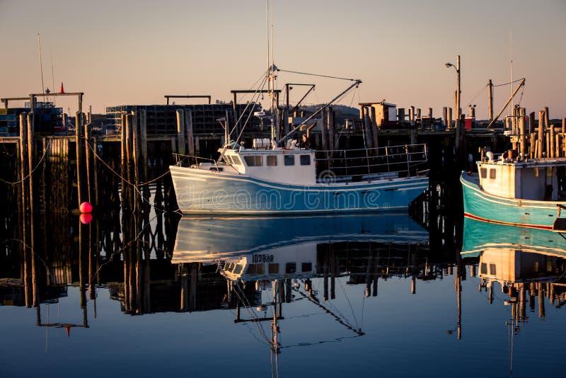 Fishing boats nova scotia. Fishing harbor and boats in Nova Scotia Canada stock photography