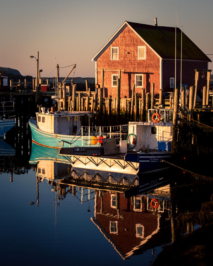 Fishing boats nova scotia. Fishing harbor and boats in Nova Scotia Canada stock image