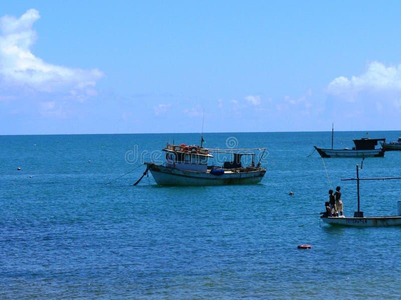 Fishing boats on ocean stock photos