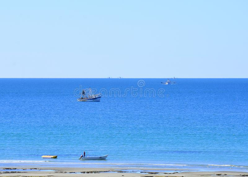 Fishing boats off a perfect Mexico beach on a summer day. royalty free stock images