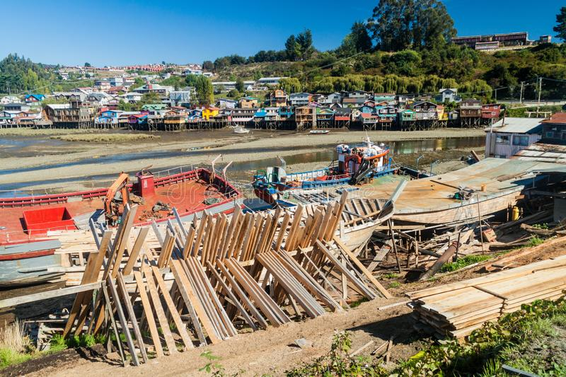 Fishing boats and palafitos stilt houses during low tide in Castro, Chiloe island, Chi. Le stock images