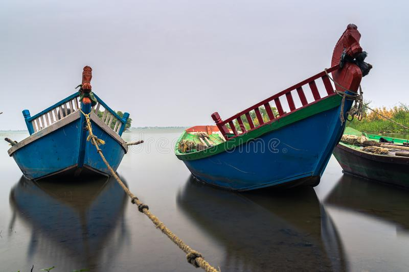 Fishing boats parked near still lake of Bhigwan, Maharashtra. Shot of Fishing boats parked near still lake of Bhigwan, Maharashtra royalty free stock images