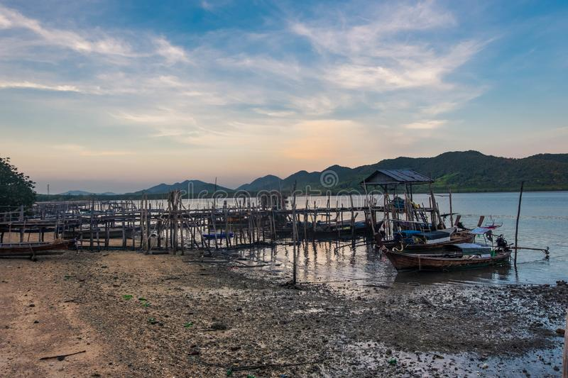 Fishing boats parked at the pier in a fisherman village with beautiful mountains and sky behind,sea south Thailand,Phang nga,Koh stock photos