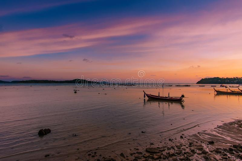 Fishing boats are parking on the sea beside Rawai beach at sunset, Phuket, Thailnad. royalty free stock photography