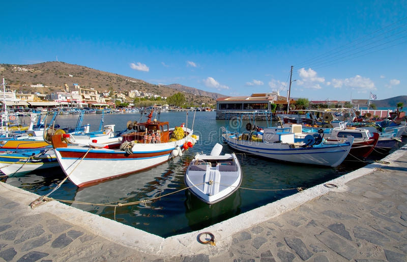 Fishing boats at the pier in Elounda royalty free stock image