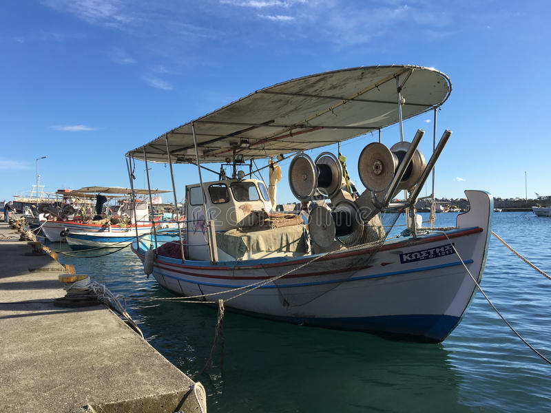 Fishing boats in Platamon. Fishing boats in the harbour of Platamon Greece royalty free stock image