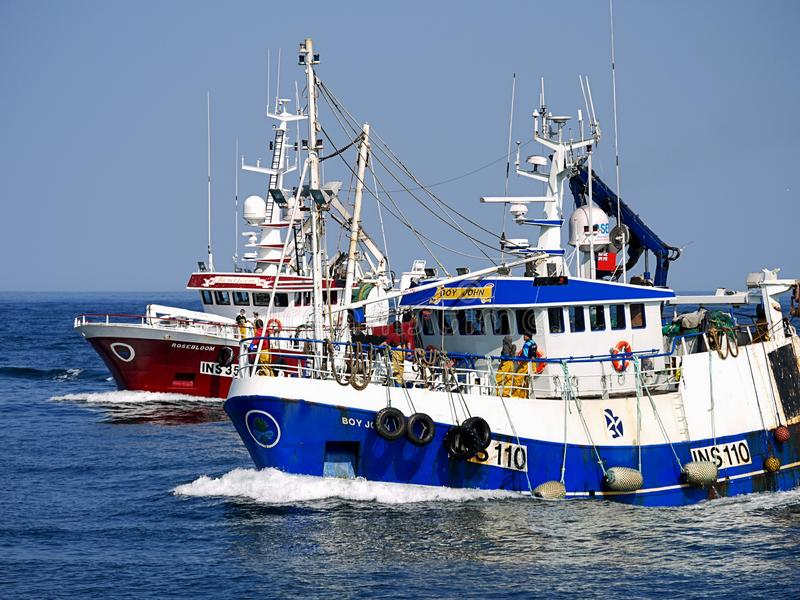 Fishing Boats Racing to Harbour. royalty free stock photography