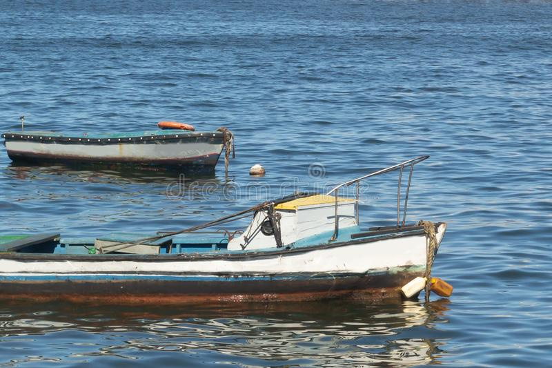 Fishing boats sail in blue water. Atlantic ocean. Havana, Cuba stock images